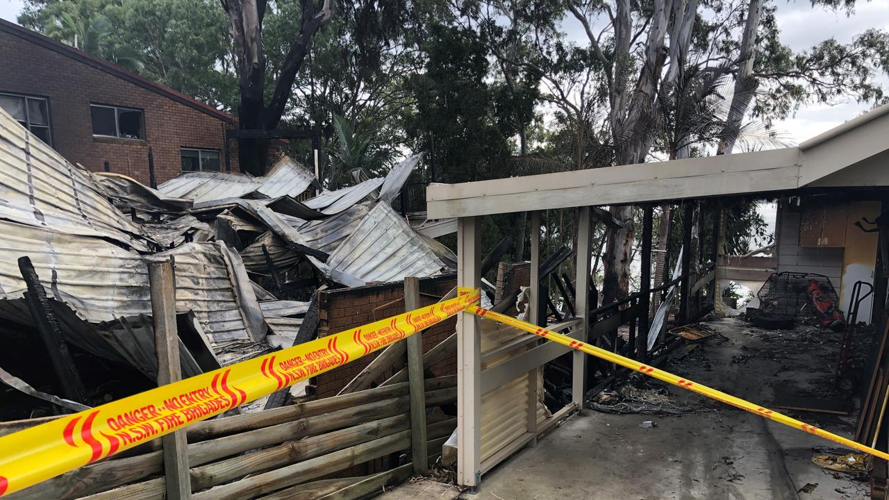 Adrian Cooney's carport is what he believes stopped his house from burning down from an inferno that started next door.