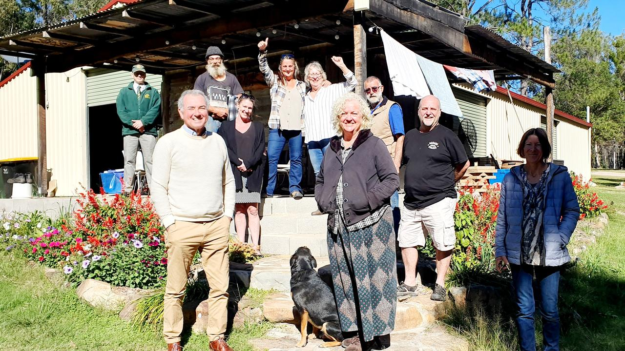 Clarence MP Chris Gulaptis is pictured with members of the Nymboida community and camera shy Judy the dog outside the 'big shed' at the Nymboida Camping and Canoeing Centre.
