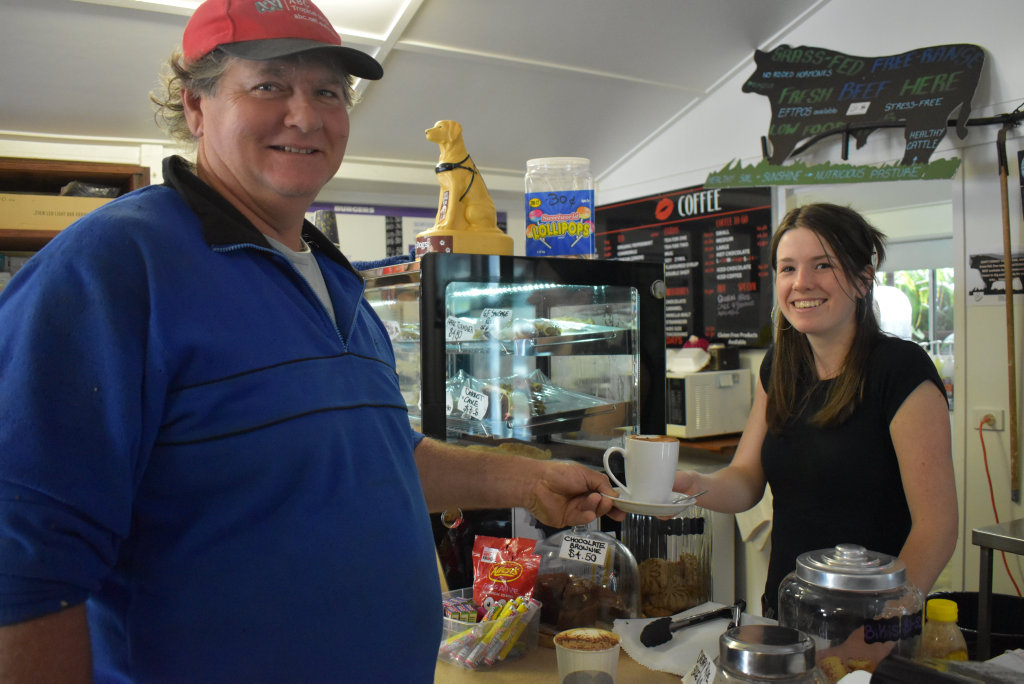 Image for sale: Eungella resident Dale Fortescue buying his last cup of coffee prepared by Indiana Sheehy at the Eungella General Store. Picture: Heidi Petith
