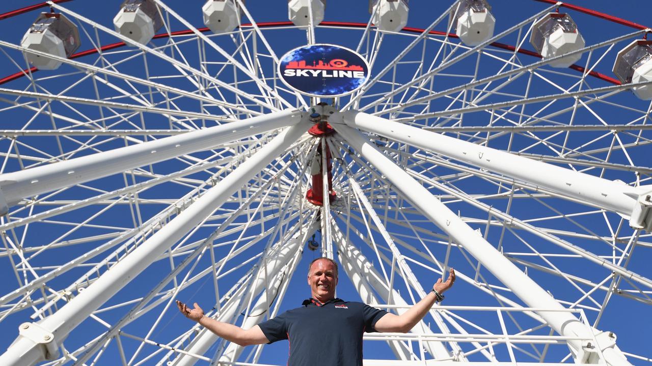Jay Jones, co-owner of the Skyline Attractions 35m ferris wheel, during set up on the Esplanade in Hervey Bay last year. Photo: Alistair Brightman