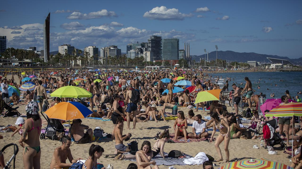 People enjoy the warm weather on the beach in Barcelona, Spain. Picture: AP/Emilio Morenatti