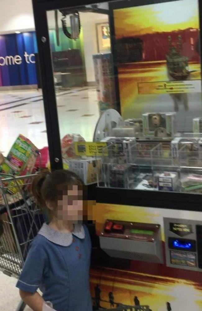 Young girl with arm stuck in vending machine at Wynnum Plaza