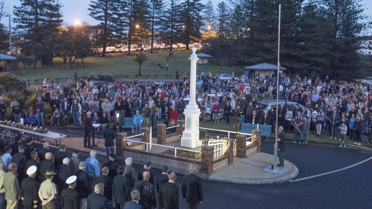 The crowd surrounds the Yamba cenotaph for the Anzac Day Dawn Service.