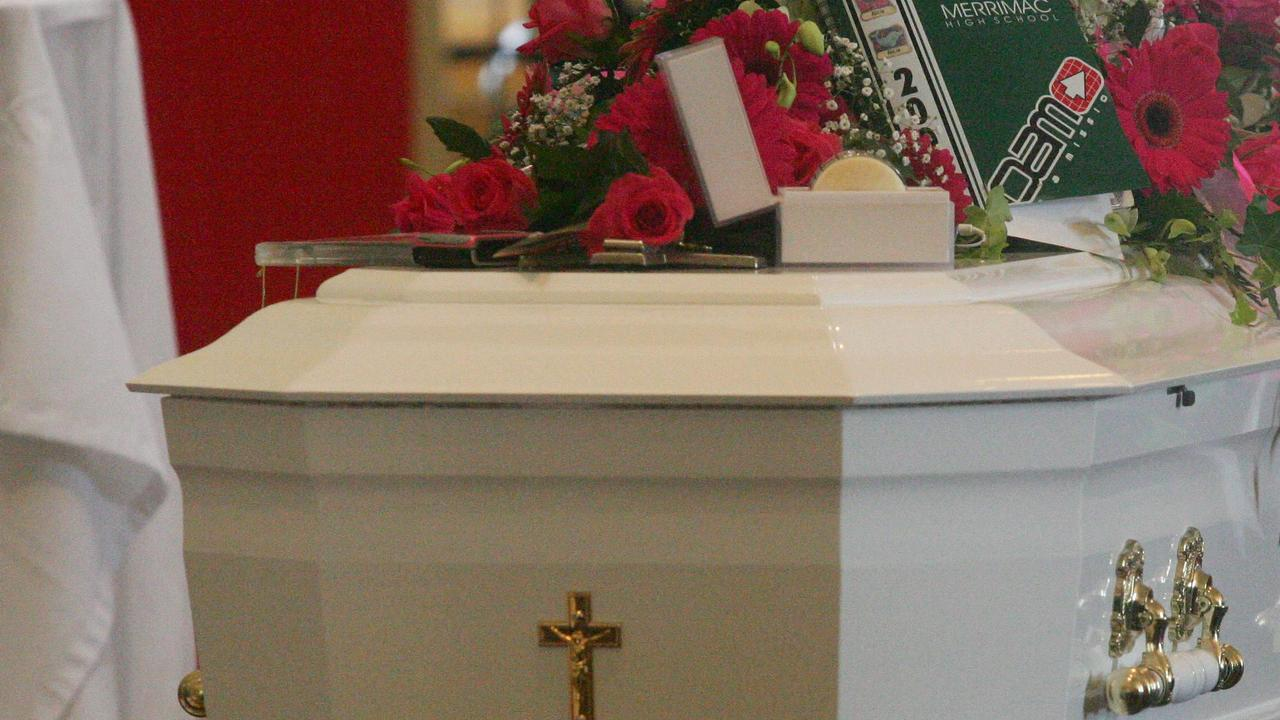 Flowers and a casket.