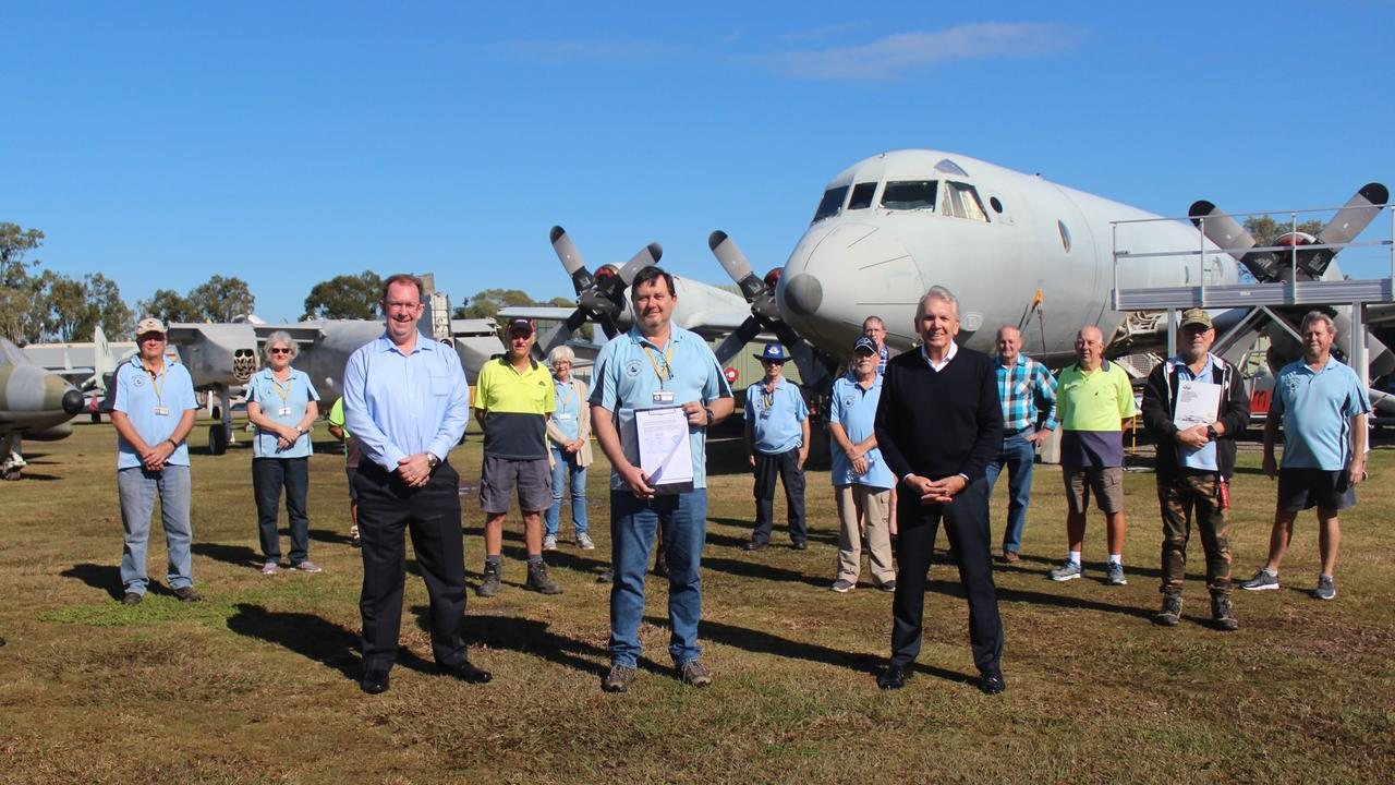 PETITION: LNP candidate for Caloundra Stuart Coward with head petitioner and Queensland Air Museum president Cameron Elmes and Mark McArdle MP and volunteers.