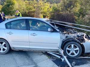Car sliced in early morning highway slide