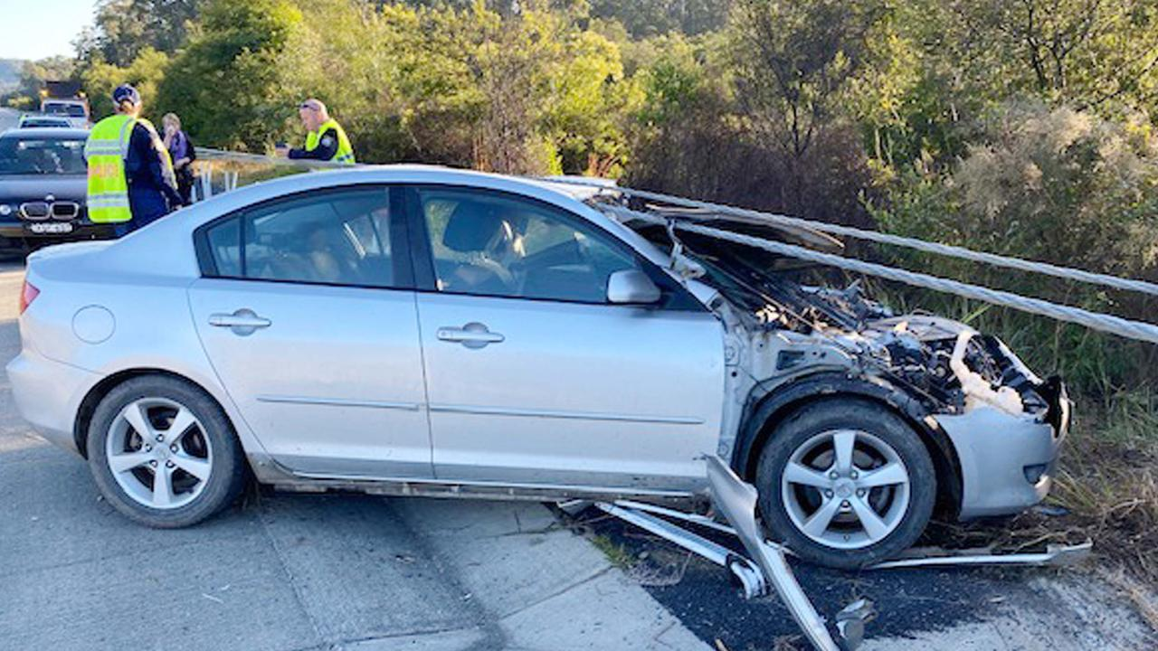 A northbound Mazda slid across all four lanes of the Pacific Highway near Urunga and struck the southbound safety barrier steel cables. Frank Redward