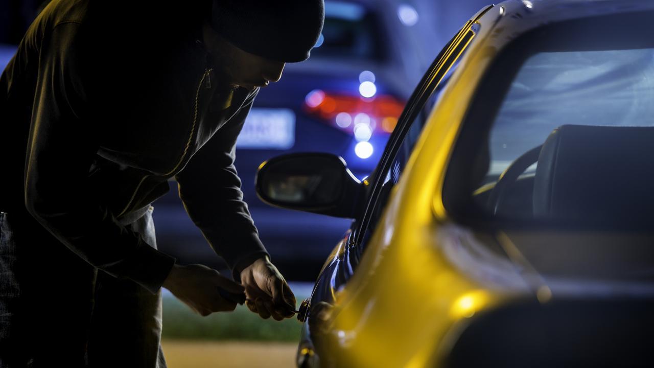 Car thief stealing a car. iStock.