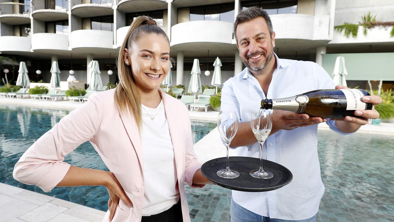 New staff member Maddison Brennan and Simon Gloftis owner of Hellenika and SK Steak and Oyster at the Calile Hotel. Picture: Josh Woning)