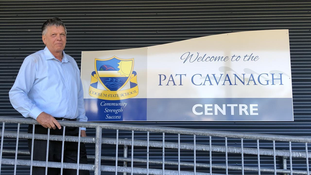 Pat Cavanagh in front of the school centre named after him.
