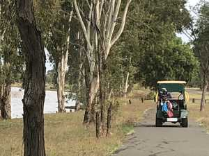A golfer drives her buggy along the Yeppen trail on
