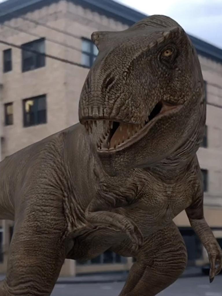 A computer-generated dinosaur terrorises a neighbourhood through a smartphone screen.