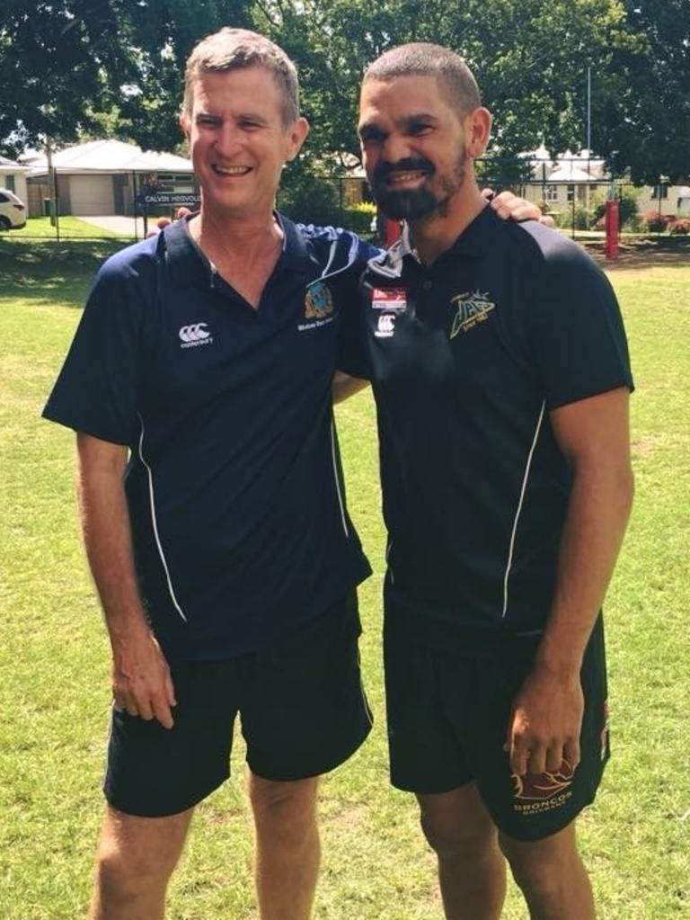 Silkstone State School PE teacher Calvin Hegvold with former student and premiership-winning footballer Wes Conlon.