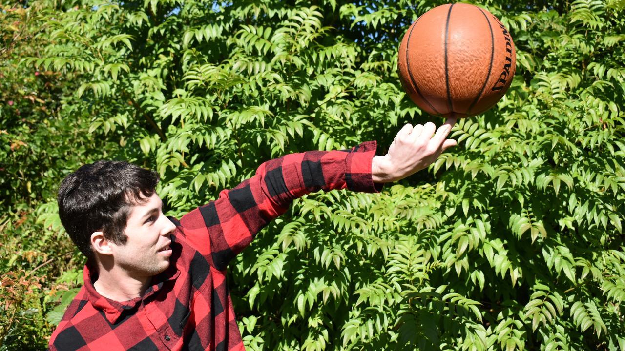Brendan Kelbie spinning a basketball. Picture: Laura Pettigrew.