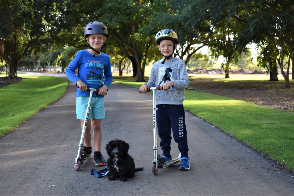 Image for sale: Henry Maitland, 7, younger brother Toby Maitland, 5, and their puppy Stella checking out the upgrades at Queens Park, Goldsmith St, Mackay. Picture: Heidi Petith