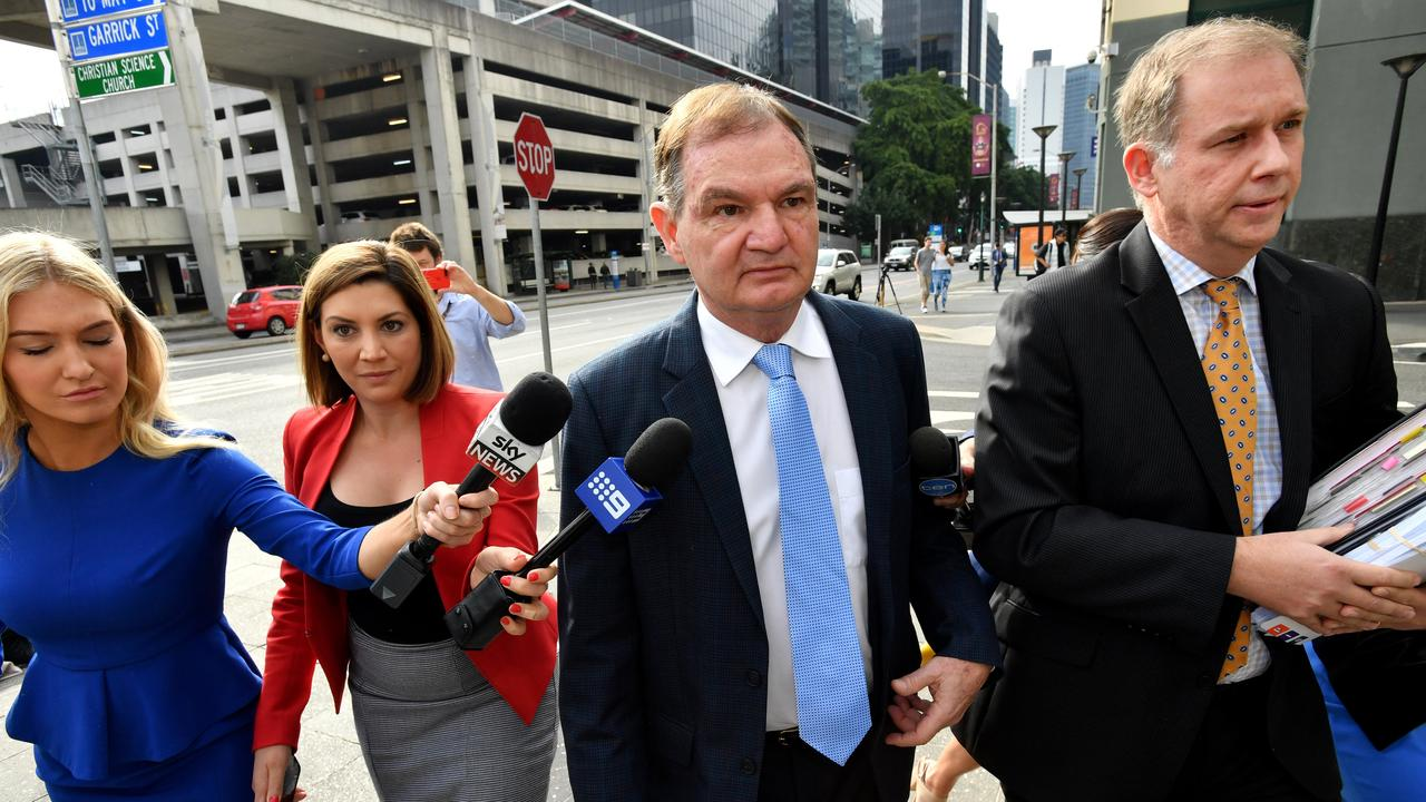 Former Ipswich mayor Paul Pisasale (centre) arrives at the Brisbane Magistrates Court in Brisbane, Wednesday, August 23, 2017.