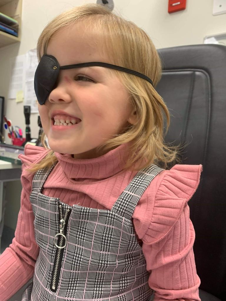 Lara Whitaker wearing an eye patch after her last ophthalmology appointment.