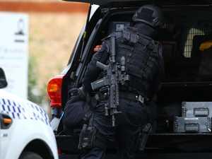 Cops reject coroner's fatal siege 'Hollywood myth'
