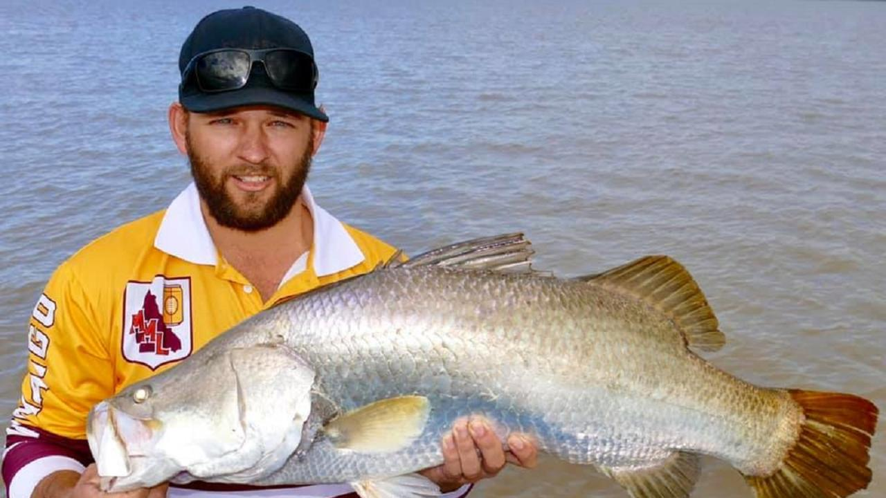 Kurt with a fine winter barra on Guided Fishing DownUnder