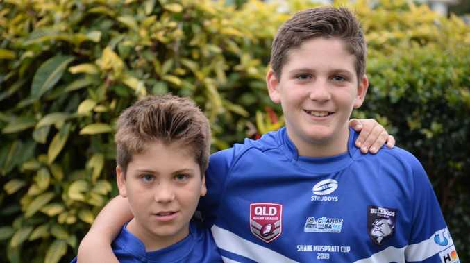 Broken arm can't dim Brothers' return to footy