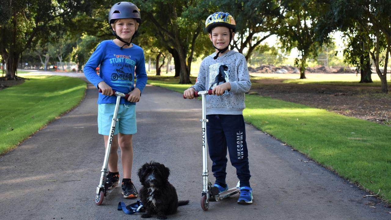 Henry Maitland, 7, younger brother Toby Maitland, 5, and their puppy Stella checking out the upgrades at Queens Park, Goldsmith St, Mackay. Picture: Heidi Petith