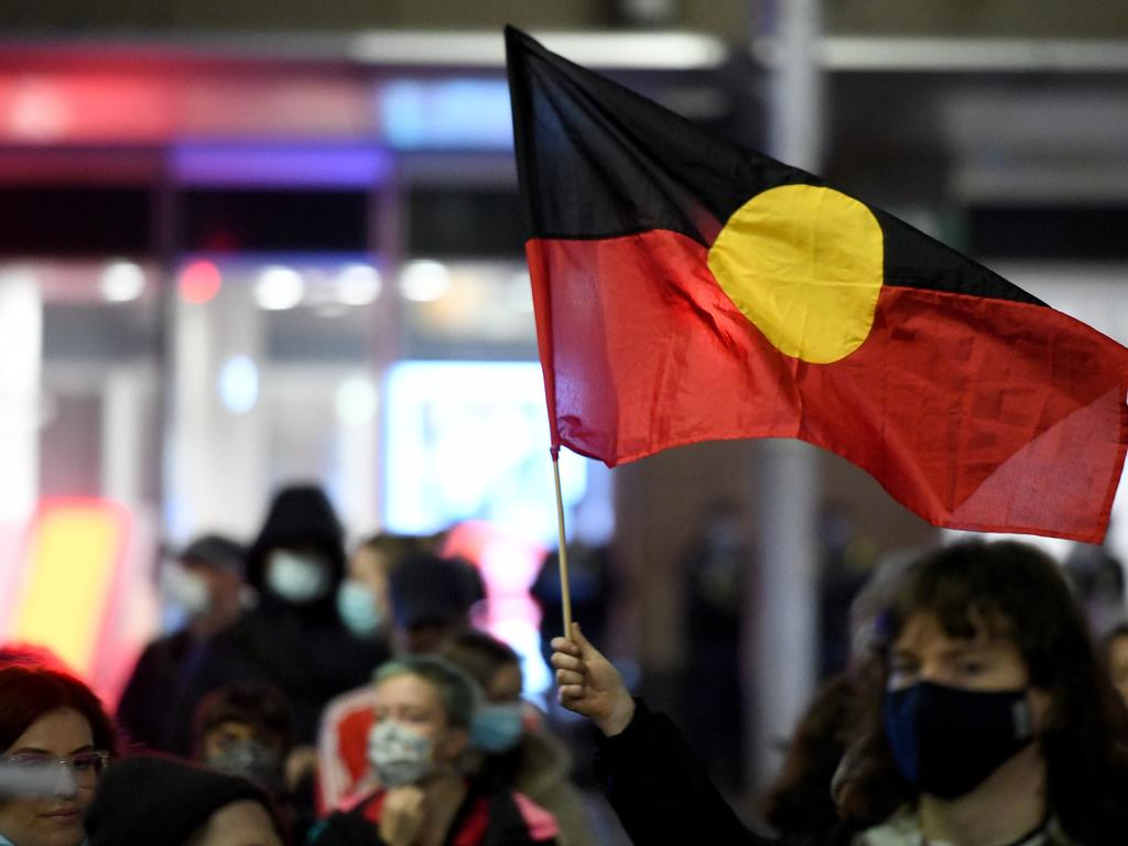 The Aboriginal flag is seen during vigil to protest Aboriginal deaths in custody. Picture: AAP Image/Bianca De Marchi