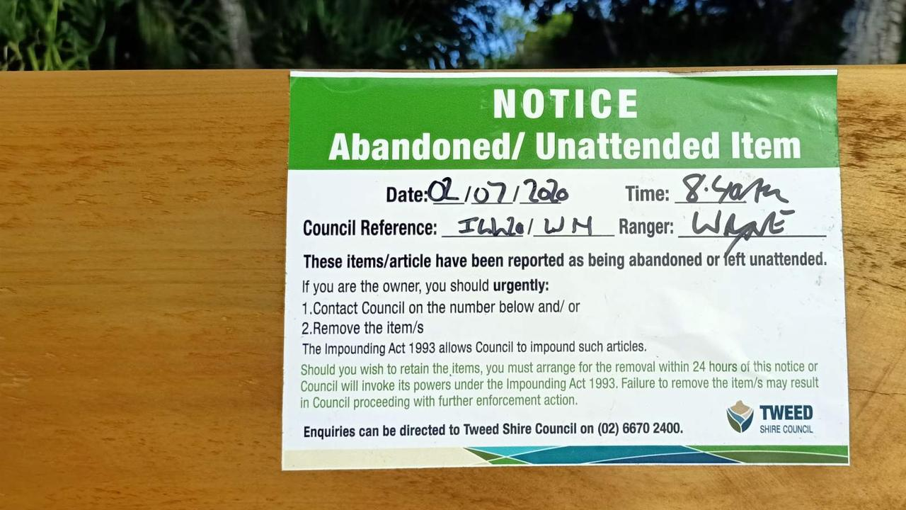 The warning Tweed Shire Council placed on beachside benches installed by the public on Salt beach yesterday.