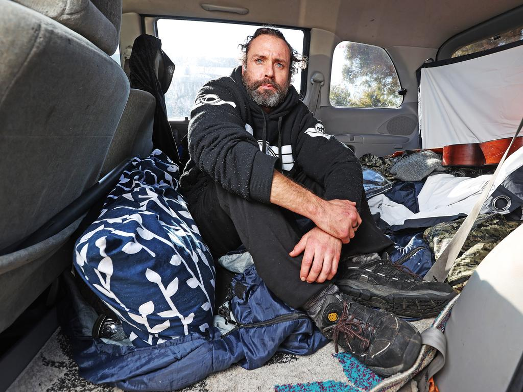 Matthew Rooke has been sleeping in his car as the unit he is living in in South Hobart has been overtaken with mould. Picture: ZAK SIMMONDS
