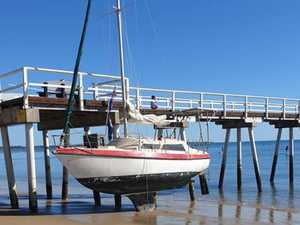 BEACHED: Boat left high and dry on sand near Bay pier