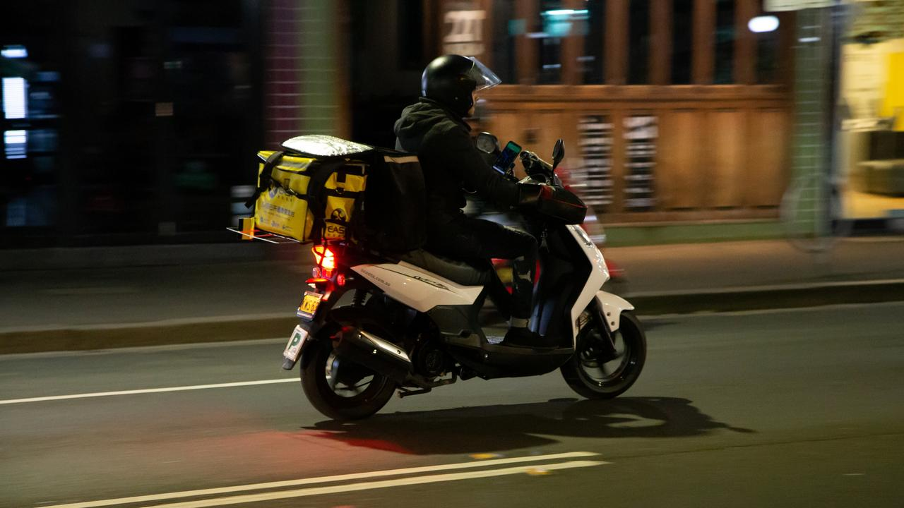 A Menulog courier delivers a takeaway food order.