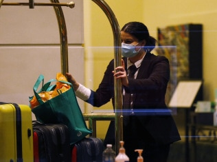 Staff inside the Stamford Hotel in Melbournemoving luggage for guests in quarantine. Picture: Darrian Traynor/Getty Images