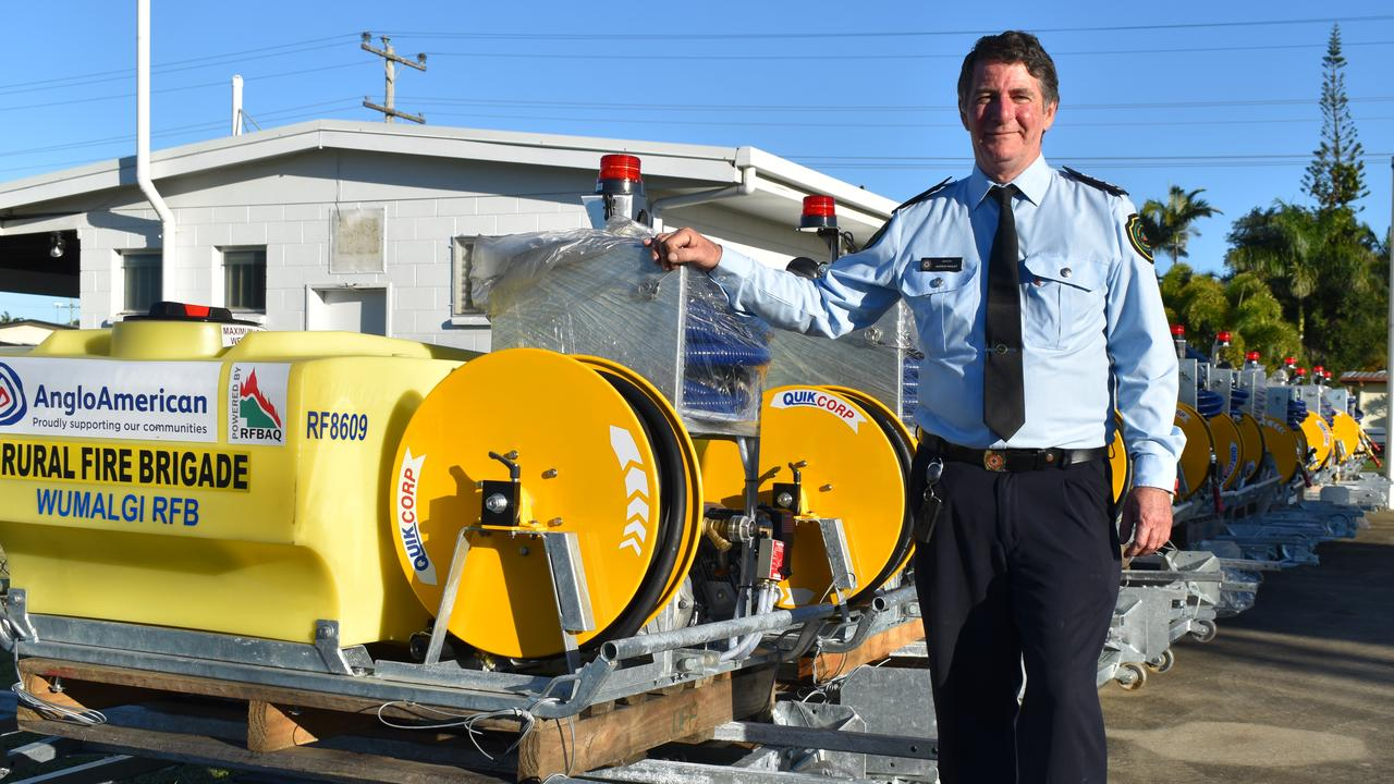 Rural Fire Service Mackay area director Andrew Houley with the 'slip-on' units donated by Anglo American. Picture: Heidi Petith
