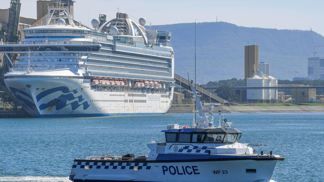 Water police patrol the contaminated cruise ship Ruby Princess while it berthed in Port Kembla in April. Picture: Simon Bullard