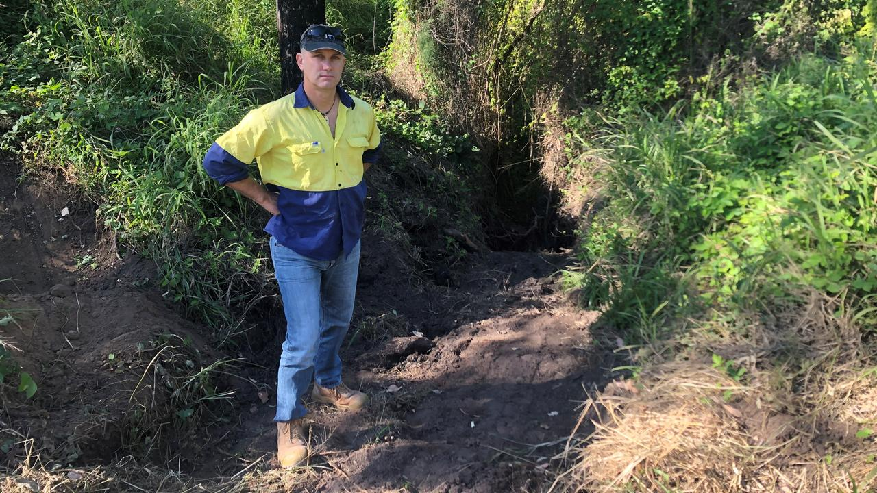 Neil Digman has lost some of his property to an eroded gully at Karalee.