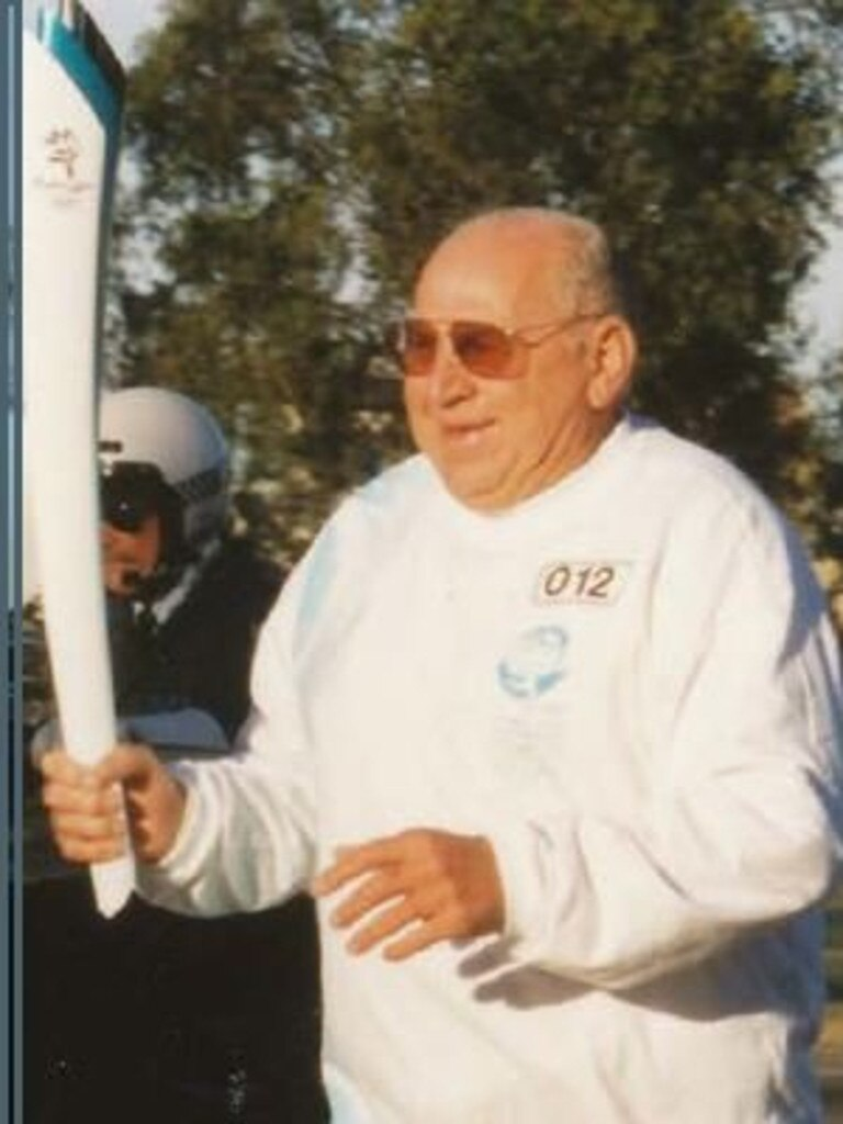 One of Norm Rule's proudest moments, carrying the Sydney Olympic torch.