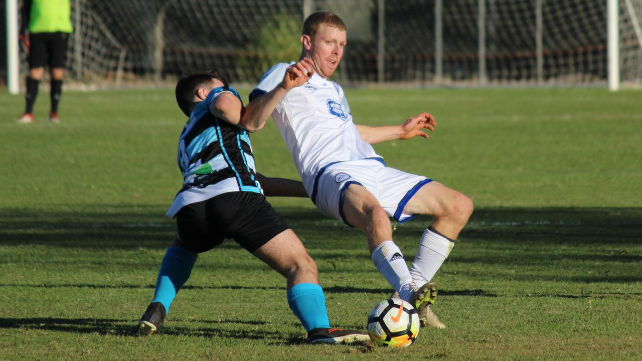 Northern Storm's Jamie Kennedy is challenged by his Taree Wildcats opponent in round one of the inaugural Coastal Premier League season at Korora on Saturday, July 4, 2020. Photo: Mitchell Keenan