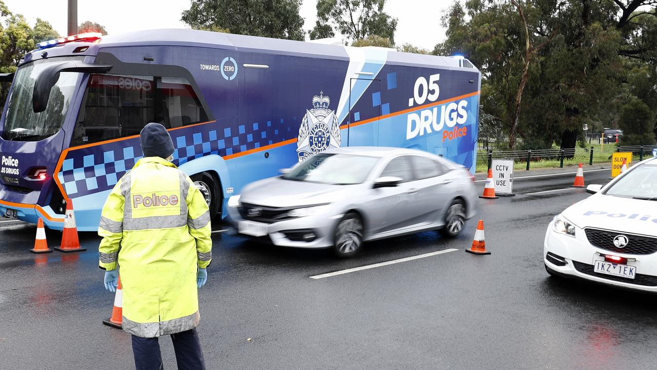 Victoria Police set up a check point in Melbourne as residents are restricted in 10 postcodes are forced into lockdown. Picture: Darrian Traynor/Getty Images