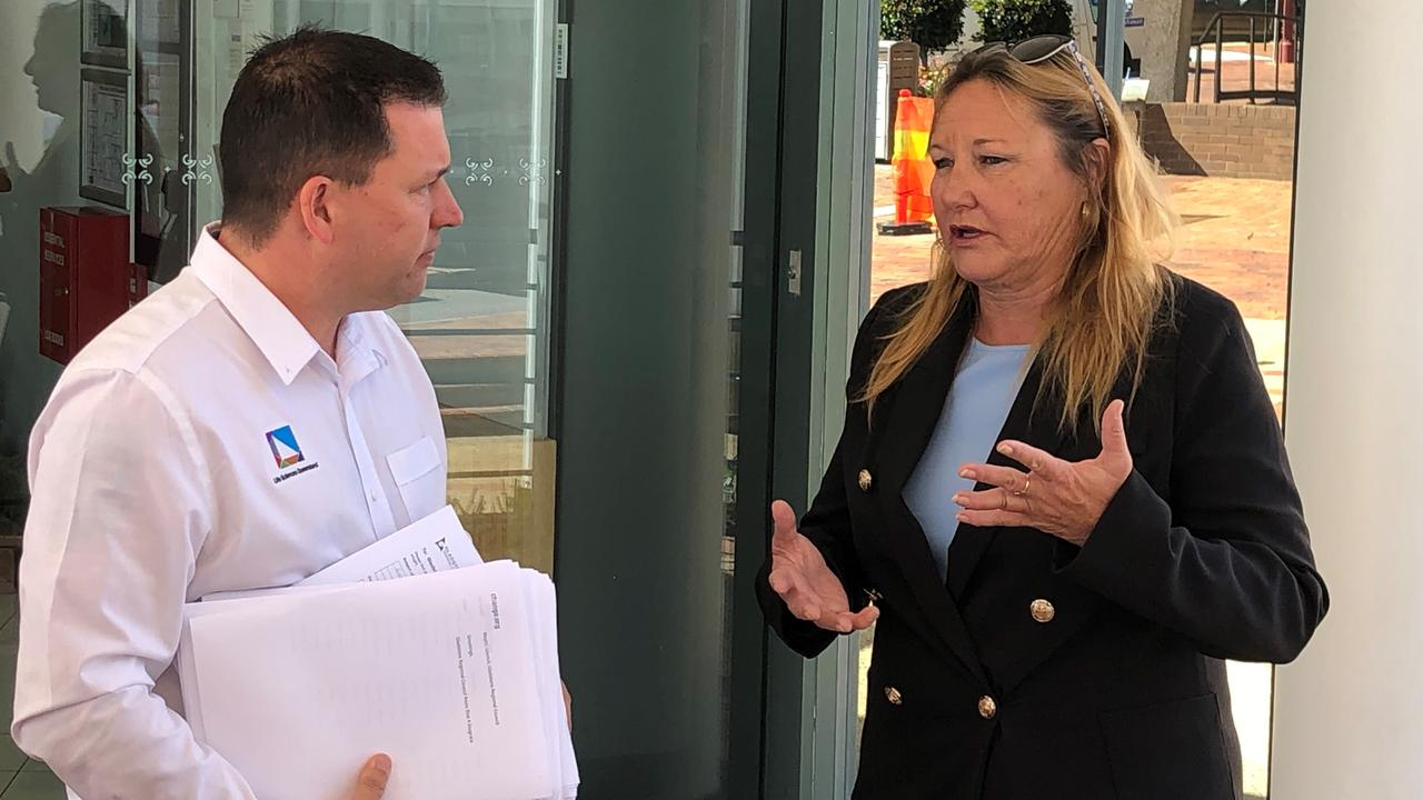 Mayor Matt Burnett receives a petition for a rates reduction and freeze from Jo-Ann Cuthbertson.