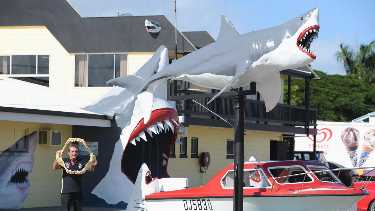 Vic Hislop in 2013 with a set of jaws from a 5.3m tiger shark caught off Point Vernon in 2012. Pictured outside his shark show on the Esplanade at Urangan. Photo: Alistair Brightman / Fraser Coast Chronicle