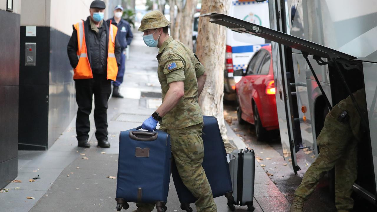 Other states and nations have been praised for their quarantine measures because they're not using private contractors. In this photo, the ADF are taking luggage into the TraveLodge Hotel in Sydney. Picture: Tim Hunter.