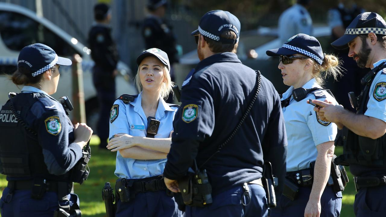 Dozens of police are positioned around The Domain at the protest. Picture: David Swift