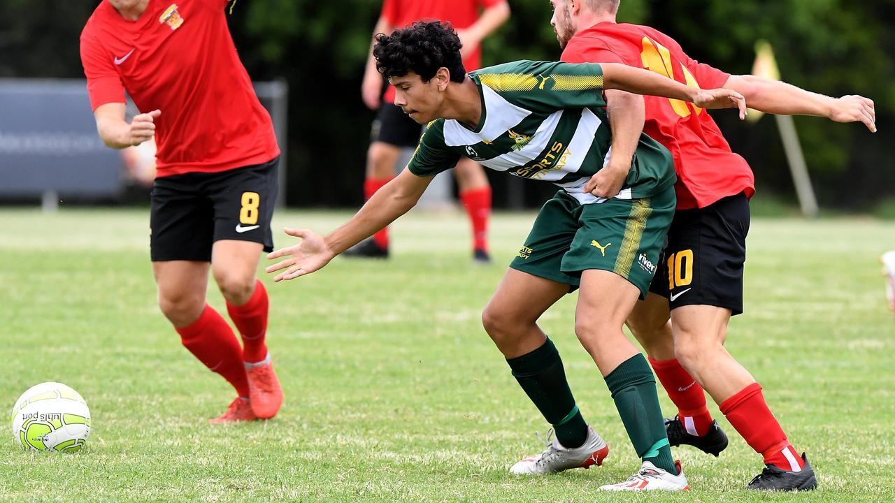 Western Pride footballer Jacob Advaney fends off a Sunshine Coast Fire player during an earlier Queensland Premier League match this season. Picture: Warren Lynam