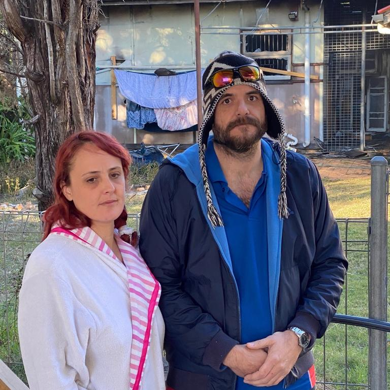 Damian Jackwitz and Leah Gillham were forced to try breaking through a wall to get to a teen trapped inside the property. Picture: Peter Wallis