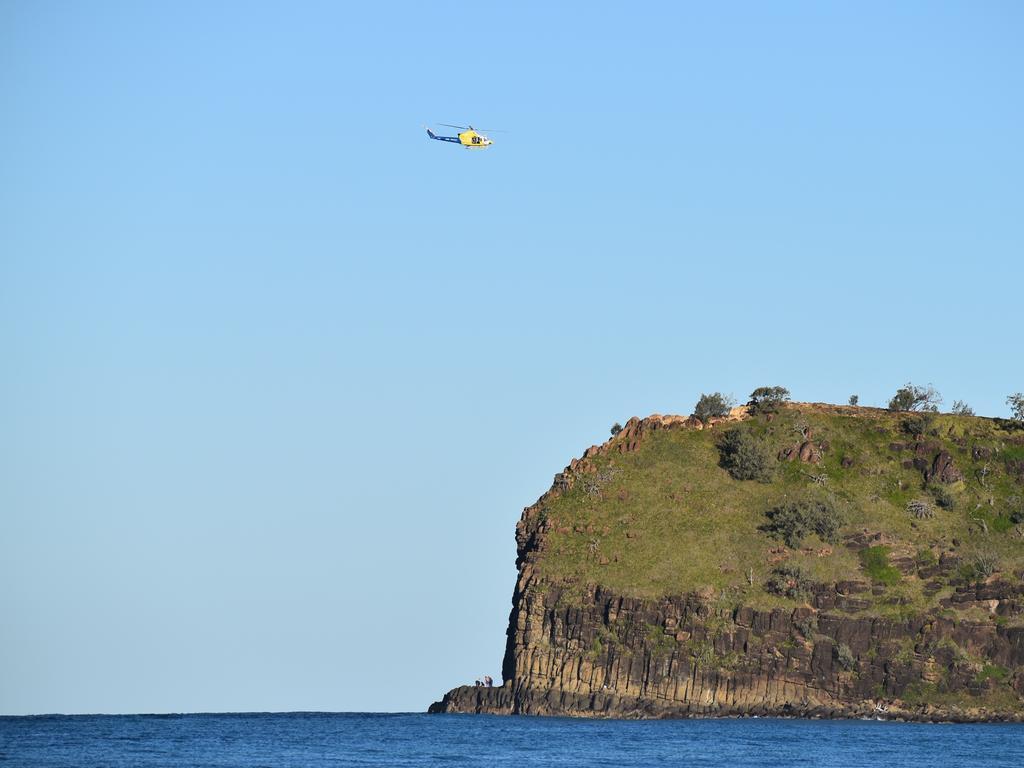 The body of shark victim Matthew Tratt is flown from Indian Head on Fraser Island.