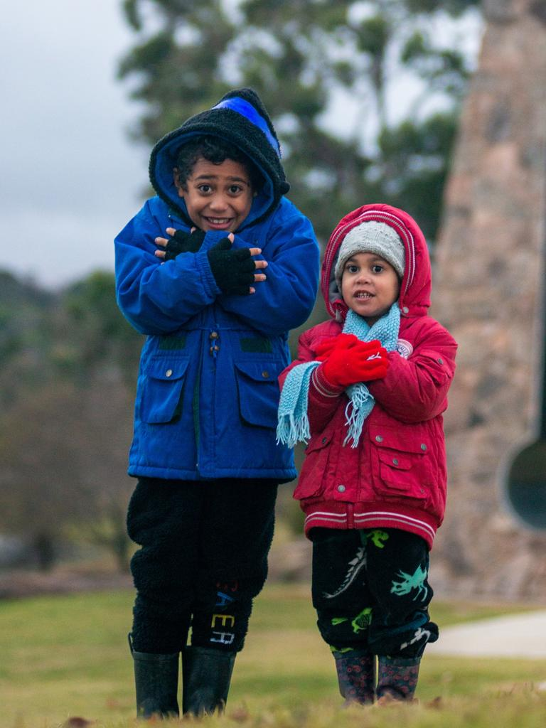 August Jones- Fama'aea 6 yrs old and sister Olive 3yrs dressed for Queensland's cold mornings these past two day. Pic Liz Fama'aea