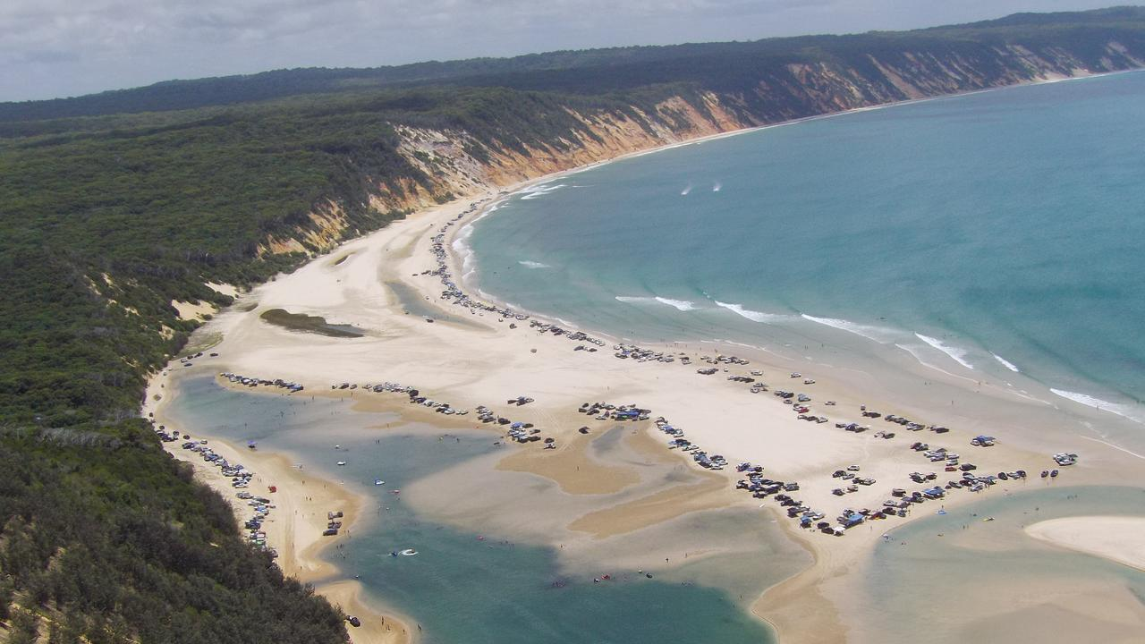 BEACH GRIDLOCK: Huge crowds at the Cooloola Coast turn the beach at Double Island Point into a very busy car park