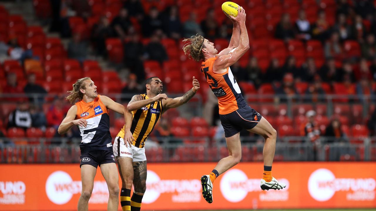 SYDNEY, AUSTRALIA – JULY 05: Lachlan Keeffe of the Giants marks during the round 5 AFL match between the Greater Western Sydney Giants and the Hawthorn Hawks at GIANTS Stadium on July 05, 2020 in Sydney, Australia. (Photo by Mark Kolbe/Getty Images)