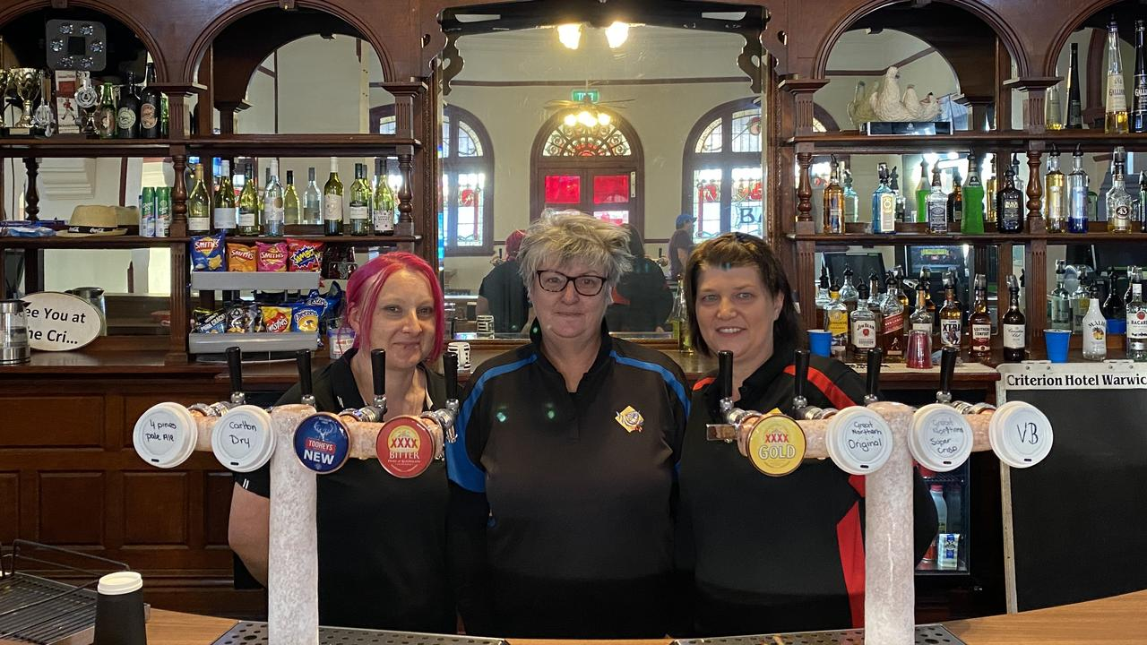 BEHIND THE BAR: Karla Domjahm, Debbie Lowe, and Kylie Jenner at the Criterion Hotel are excited to be back and serving the Warwick community. Picture: Jessica Paul