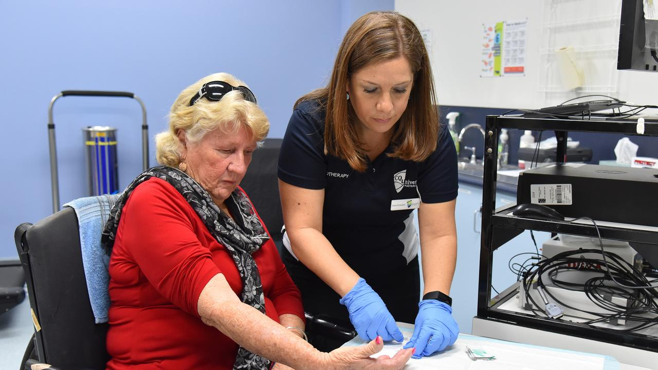Dr. Vanesa Bochkezanian and patient Robynne Clifton undertake an early trial of the bionic glove