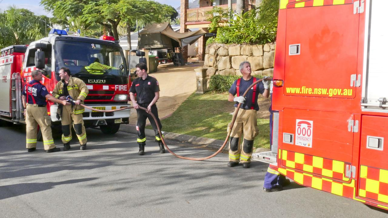 Firefighters from Banora Point and Tweed Heads NSW Fire and Rescue stations packing up after attending a house fire in Widgee Ave in Banora Point. Photo: Jessica Lamb